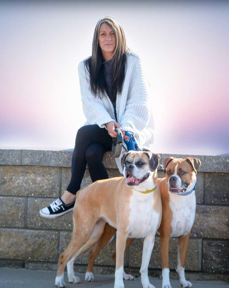 Kim Mancini with 2 dogs
